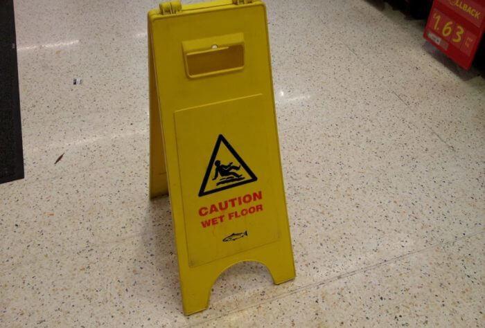 Wet floor sign in supermarket slip accident claim